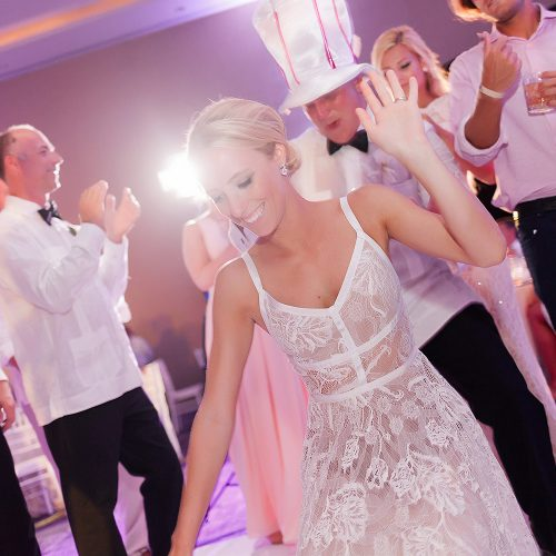 Bride dancing and having fun at her Hard Rock Cancun Wedding reception