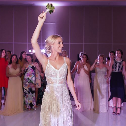 Bouquet tossing at Hard Rock Cancun wedding reception