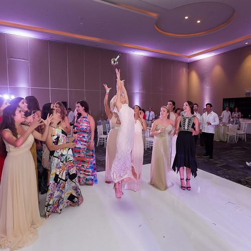 Bouquet catching at Hard Rock Cancun Wedding reception