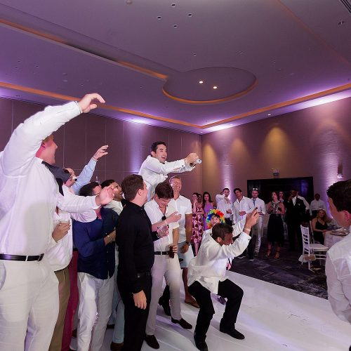 Groomsmen having fun at Hard Rock Cancun wedding reception