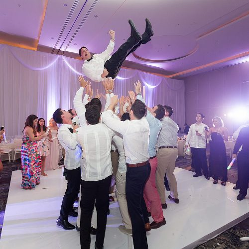 Groom being tossed at Hard Rock Cancun Wedding Reception