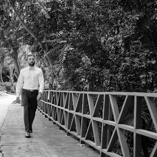 Groom walking to wedding ceremony at Azul Fives Hotel, Riviera Maya