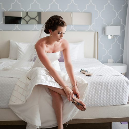 Bride putting on shoes before wedding at Azul Fives Hotel, Riviera Maya