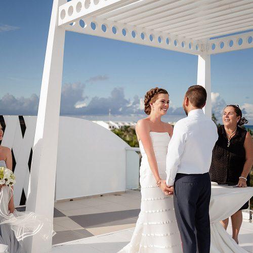 Bride and groom at wedding ceremony at Azul Fives Hotel, Riviera Maya