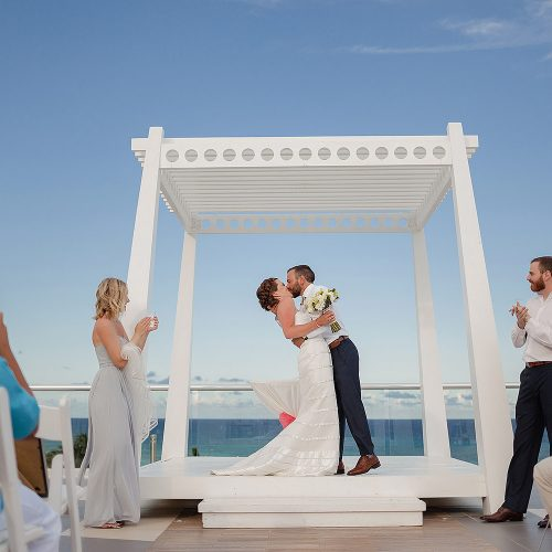 Bride and grooms first kiss at Azul Fives Sky Deck