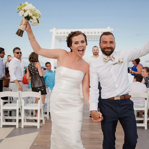 Bride and groom celebrating after ceremony at Azul Fives Hotel, Riviera Maya