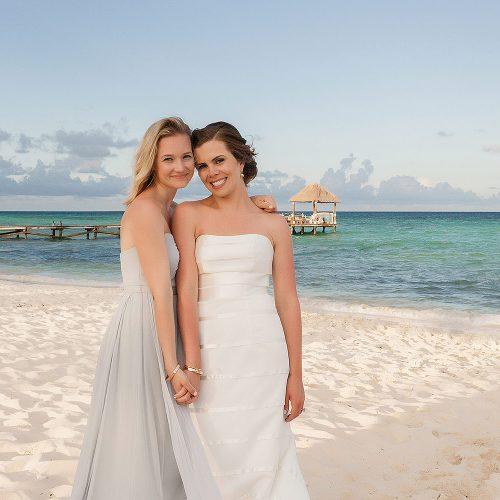 Bride and bridesmaid on beach at Azul Fives Hotel, Riviera Maya