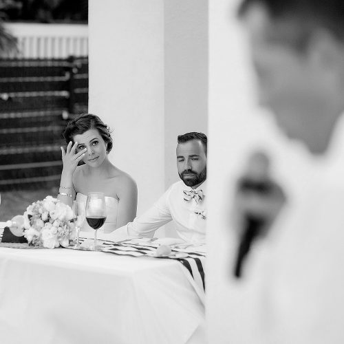 Bride crying during speech at wedding.