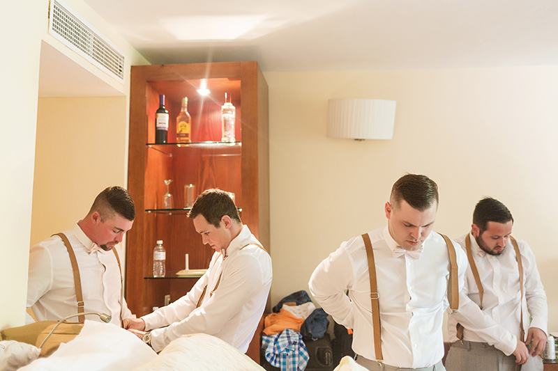 Groomsmen getting ready at the Excellence Playa Mujeres wedding