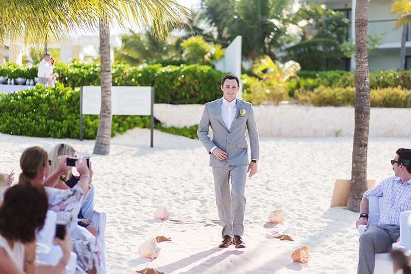 Groom walking down aisle at Excellence Playa Mujeres beach wedding