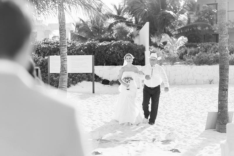 Bride walking down aisle at  beach wedding