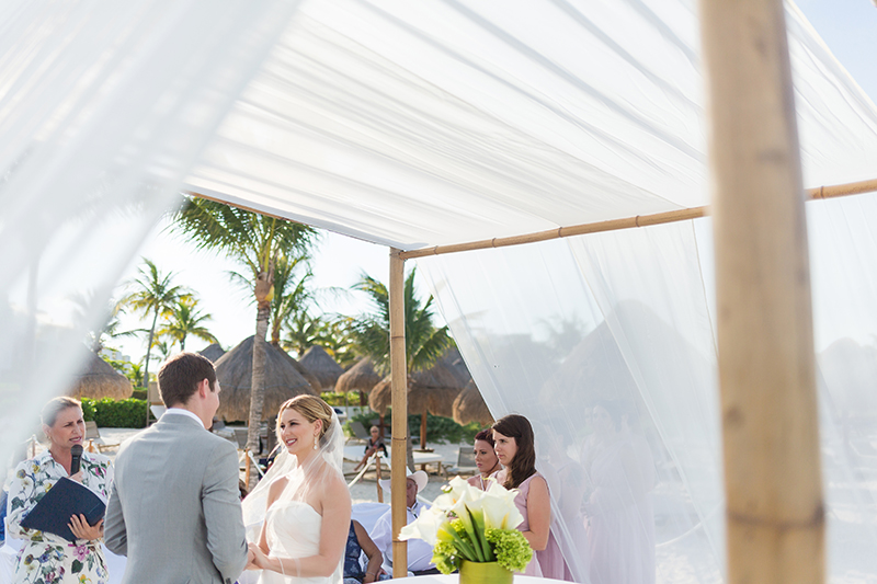 Bride and groom at wedding ceremony at Excellence Playa Mujeres