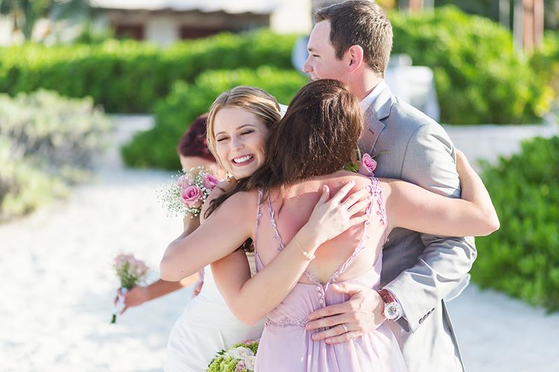 Big hugs after wedding at Excellence Playa Mujeres