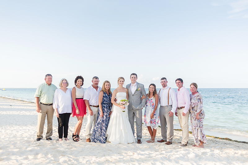 Family portrait at Excellence Playa Mujeres wedding