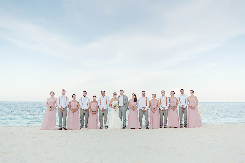 Bridal party on beach at Excellence Playa Mujeres wedding