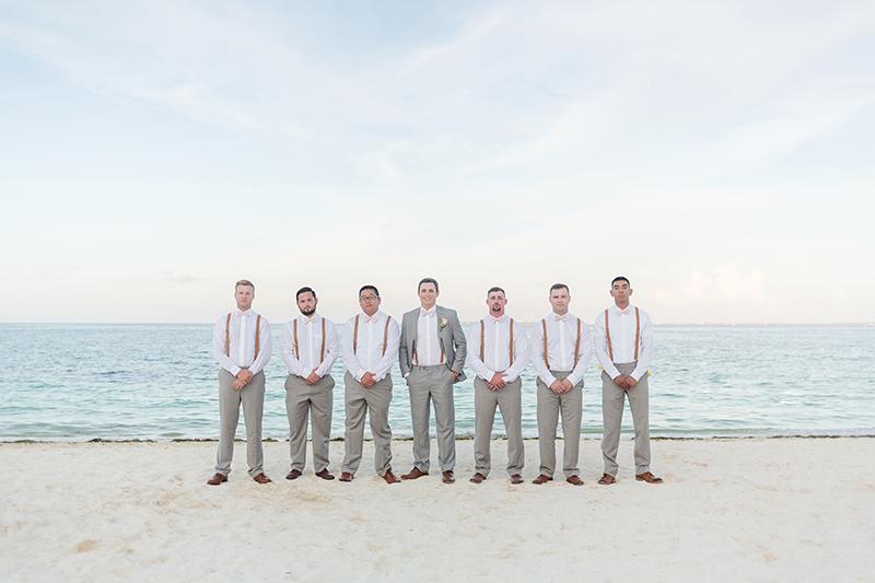 Groomsmen on beach after wedding