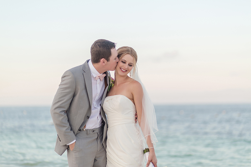 Bride and groom kissing after wedding at Excellence Playa Mujeres cancun