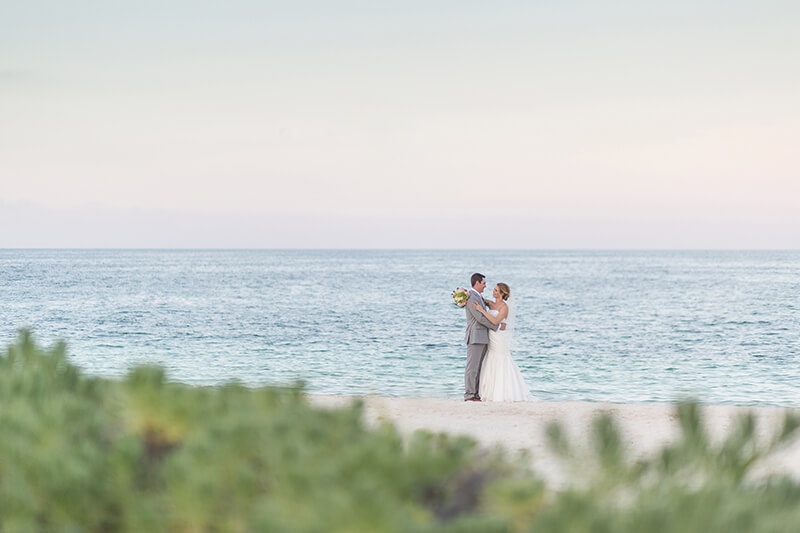 Bride and groom on beach at Excellence Playa Mujeres wedding in cancun