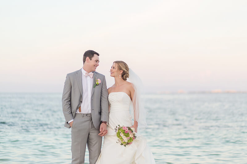 Bride and groom on beach at wedding Excellence Playa Mujeres