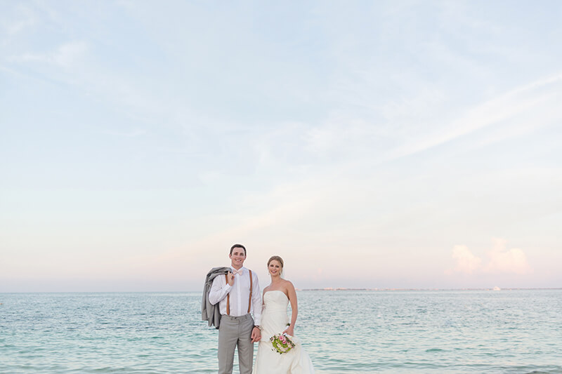 Bride and groom on beach at wedding.