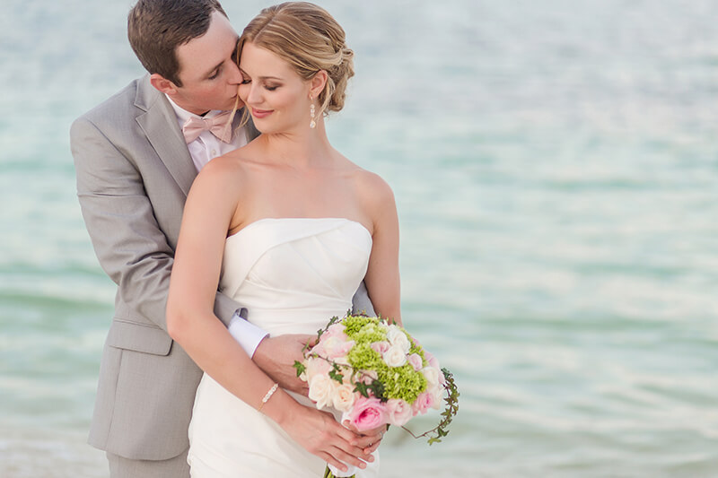 Close up of bride and groom kissing after wedding