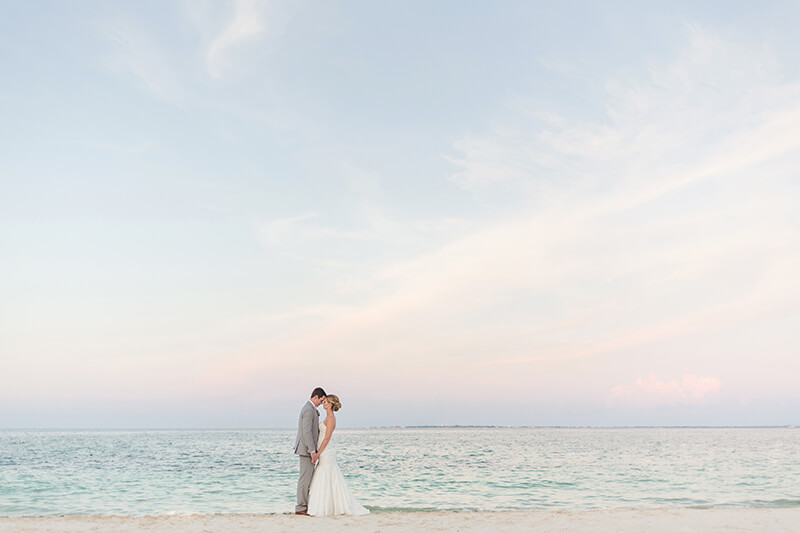 Bride and groom portrait on beach at Excellence Playa Mujeres Cancun