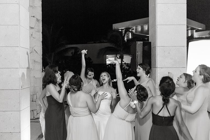 Bridesmaids dancing at Excellence Playa Mujeres wedding