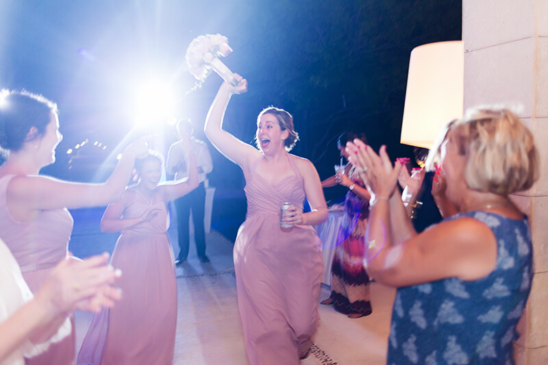 Bridesmaid after catching bouquet at Excellence Playa Mujeres wedding