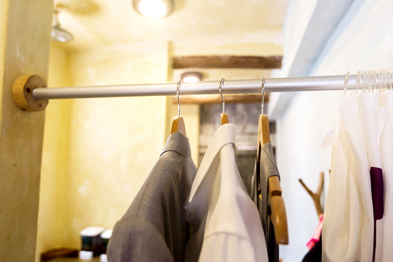 Grooms cloths right before hanging in closet