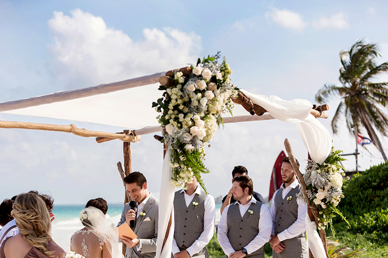 Groom laughing at wedding ceremony in Tulum