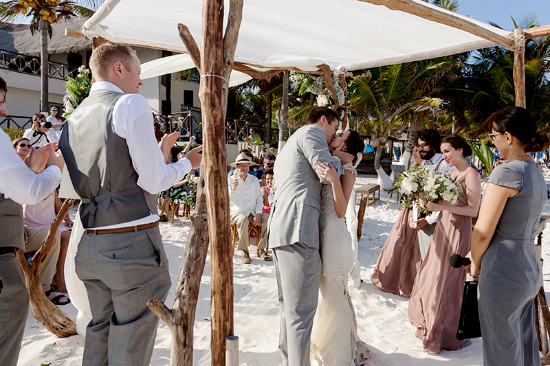 Bride and Groom kissing at wedding in Tulum