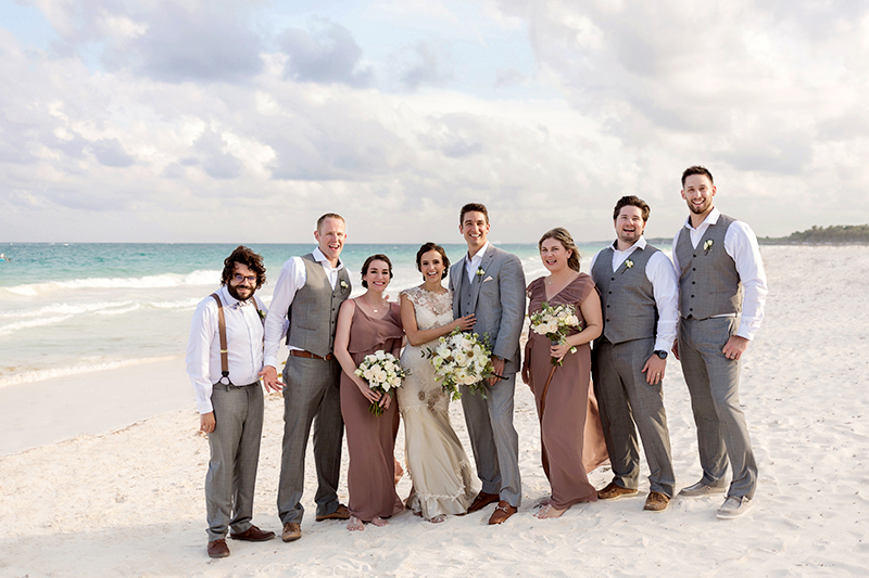 Bridal party on beach in Tulum