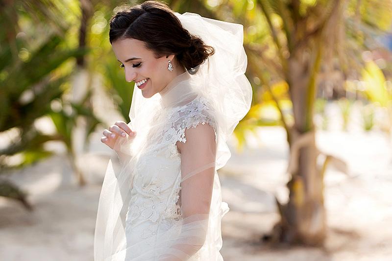 Portrait of bride laughing on beach in Tulum