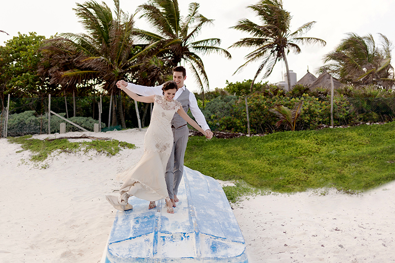 Bride and groom having fun on boat in Tulum