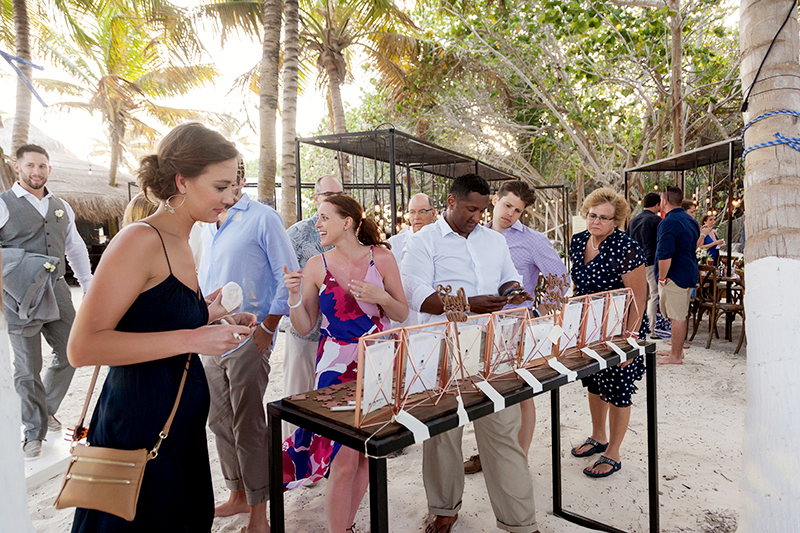 Guests finding seats at beach destination wedding