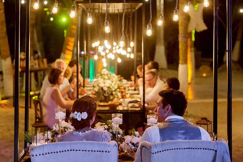 Bride and groom at outside reception tulum wedding