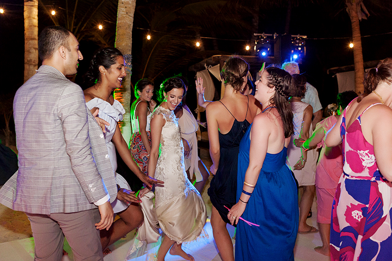 Bride and guests dancing at wedding in Tulum