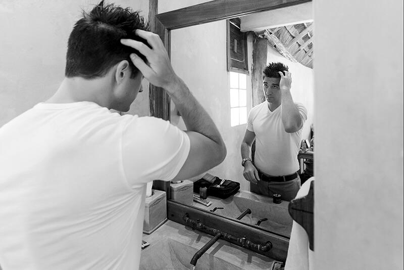 Groom getting ready for wedding in Tulum