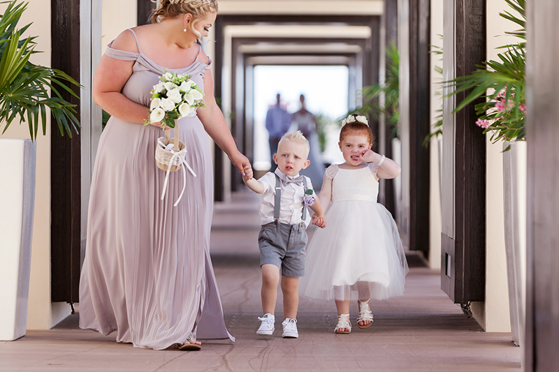 Ring Bearer and flower girl walking down Isle at Riviera Maya Wedding