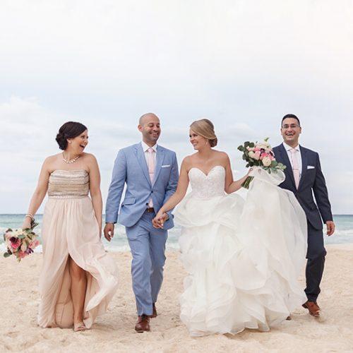 Bridal party walking on beach at Azul Fives Hotel, Riviera Maya