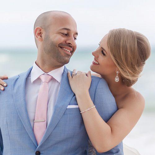Bride and groom on beach in Riviera Maya, laughing
