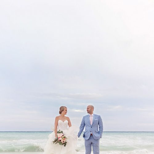 Bride and groom on beach in Riviera Maya