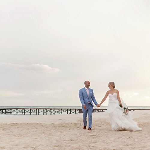 Bride and groom on beach at Azul Fives Hotel, Riviera Maya