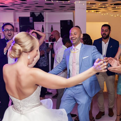 Bride and groom dancing at Azul Fives Hotel