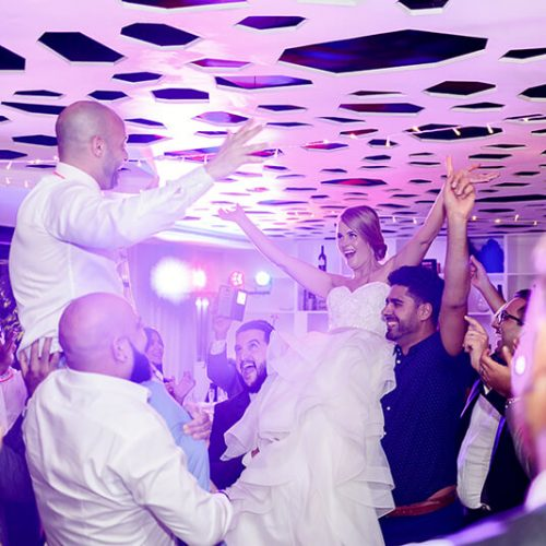 Bride having fun at reception at Azul Fives Hotel