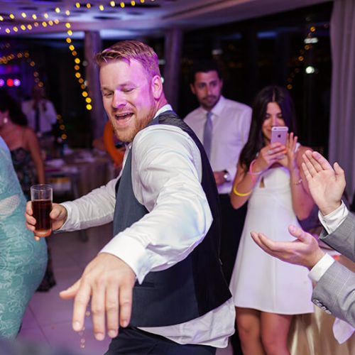 Guests dancing at Azul Fives Hotel
