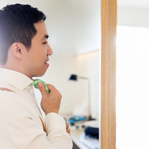 Groom getting ready for his wedding in Cancun