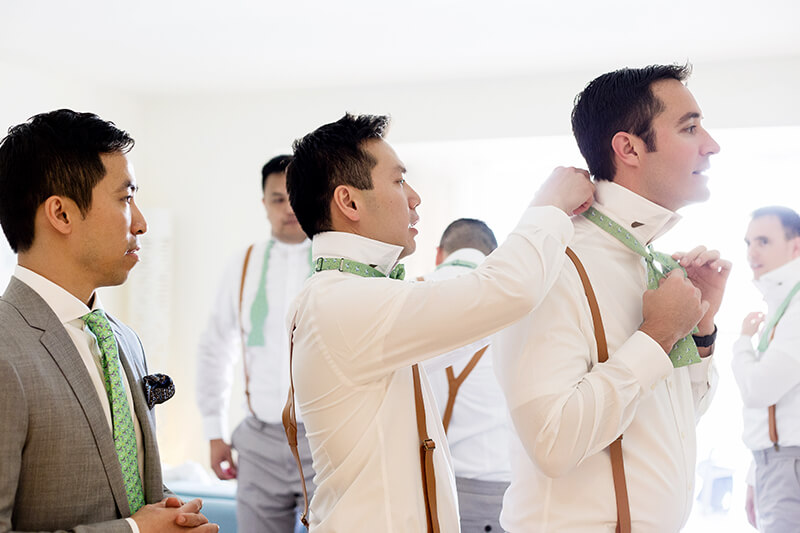 Groom and groomsmen getting ready before wedding at Finest Playa Mujeres Resort