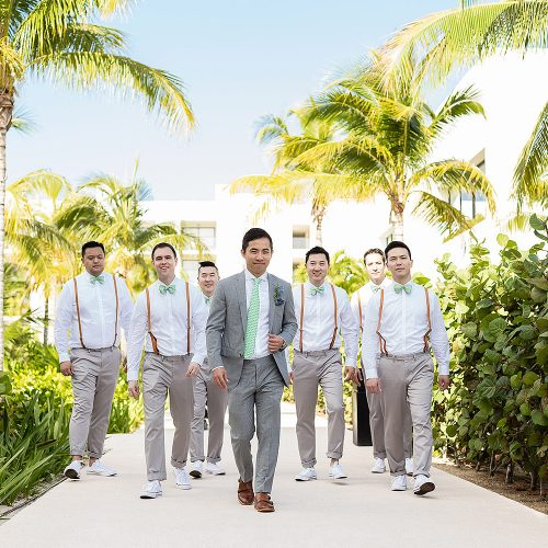 Groomsmen walking down path at Finest Playa Mujeres Resort Cancun