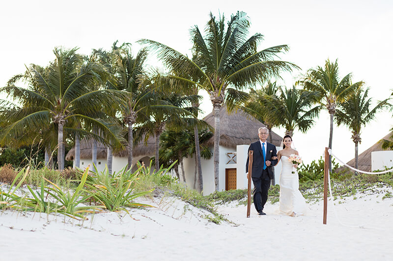 Bride walking with father on beach at Finest Playa Mujeres Wedding ceremony